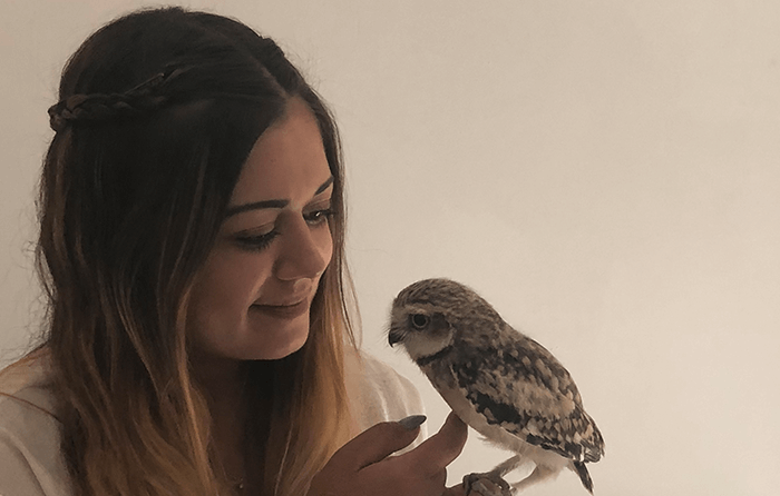 Girl holding a small bird of prey